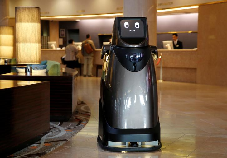 Panasonic's prototype delivery robot, HOSPI, designed to serve bottled beverages and provide bus information, is pictured at a hotel near Narita International Airport in Narita