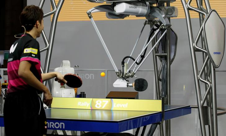 Omron Corp. demonstrates its fourth-generation table tennis robot 'Forpheus' playing with table tennis Olympic medalist Jun Mizutani at CEATEC JAPAN 2017 at the Makuhari Messe in Chiba