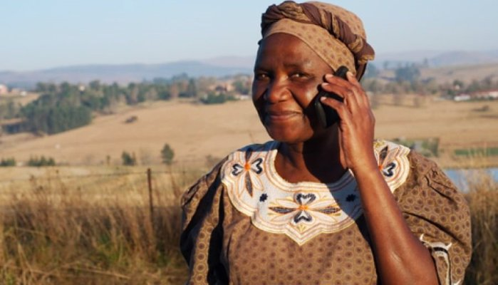 african woman on phone